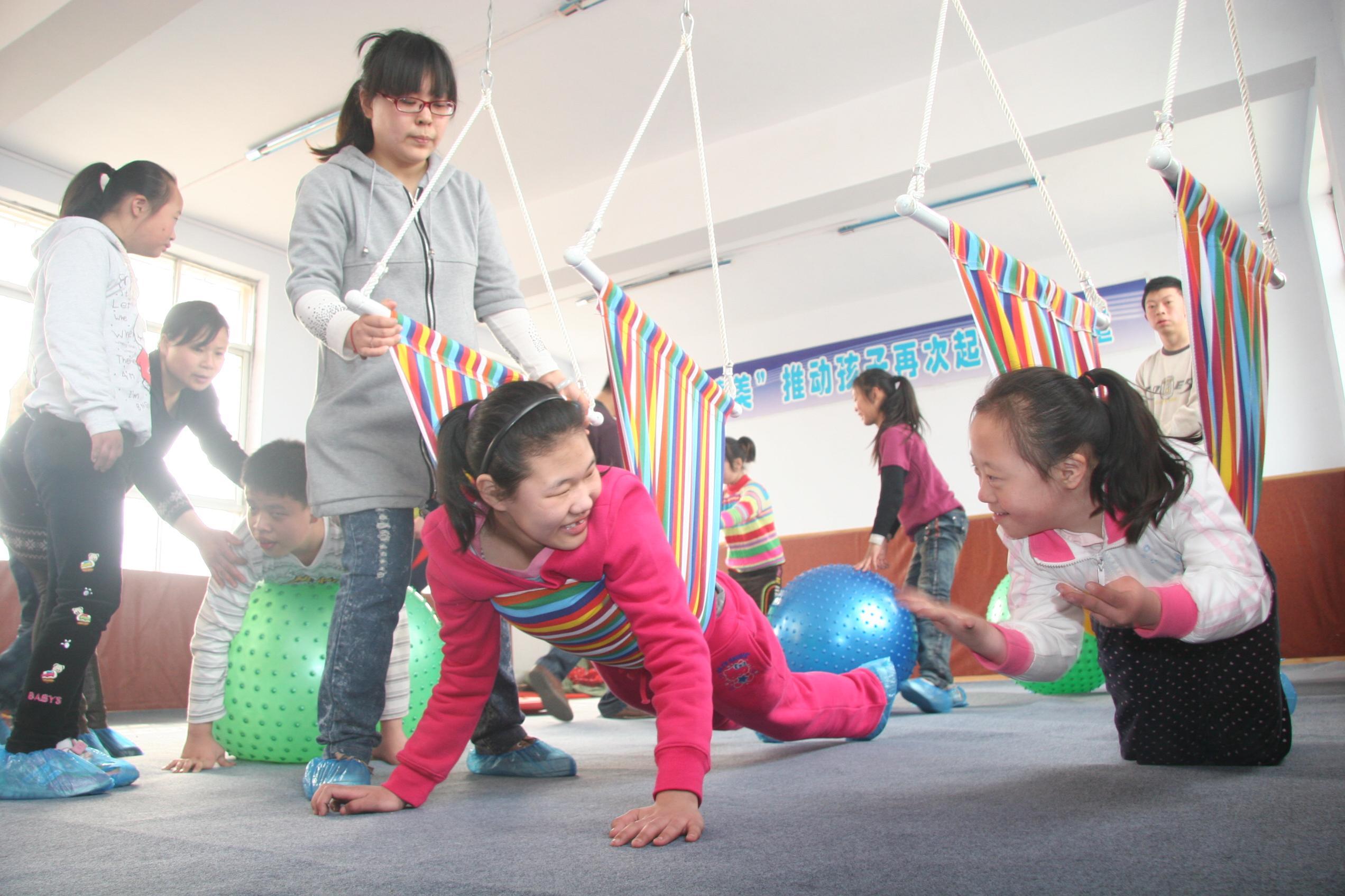 图片新闻:解放区让智障儿童成为有用之人