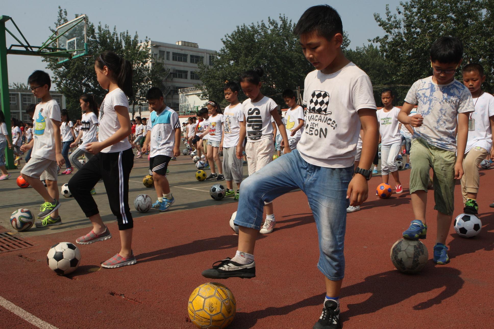 足球小学:解放区30所中小学校风靡图片操(二)新闻黄赵图片